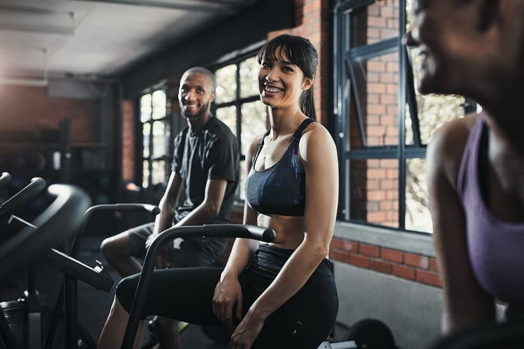 Group of People Smiling In The Gym