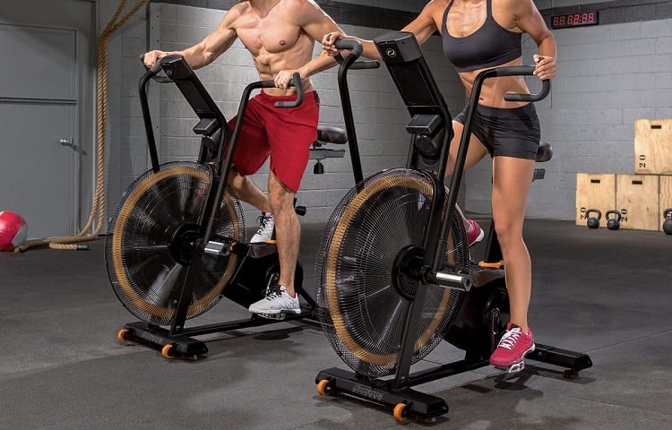 young fit couple on airbike