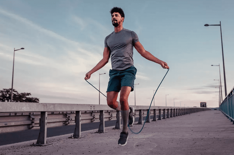 Man Jumping Over Rope